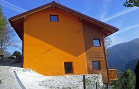Houses for sale in Slovenia. This is a terrific log cabin style house with super views, carefully designed and laid out the house offers great living accommodation