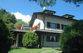 4 bedroom houses for sale in Italy. Villa with garden and a private tennis court in a peaceful area surrounded by greenery, not far from Lake Maggiore, in Gignese, Italy