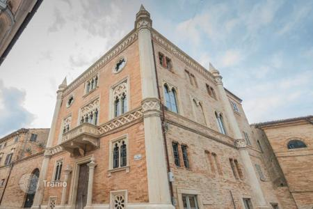 Luxury houses for sale in Marche. Venetian Gothic style building for sale in the historic Le Marche