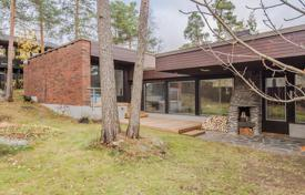Residential for sale in Finland. Comfortable townhouse with a sauna, a swimming pool and panoramic windows, surrounded by a picturesque natural landscape, Espoo, Finland