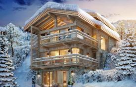 Luxury houses with pools for sale in Auvergne-Rhône-Alpes. New chalet with a terrace, balconies and bay windows, next to the ski slopes, in the resort village of Courchevel, Alpes, France
