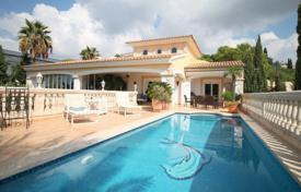 5 bedroom houses for sale in Balearic Islands. Villa with a private garden, a parking and sea views, Calvia, Spain