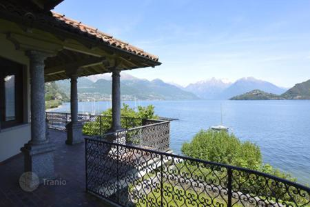 Luxury 3 bedroom houses for sale in Italian Lakes. Classical villa with a garden, a boathouse and a wonderful view of Lake Como and the mountains in Pianello del Lario, Italy