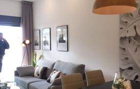 Apartments with pools for sale in Guardamar del Segura. New two-bedroom apartment with a large plot in El Raso, Alicante, Spain