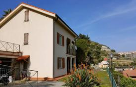 6 bedroom houses for sale in Liguria. Sea view villa in Ospedaletti, Italy. Large garden with a barbecue area, a swimming pool and a garage