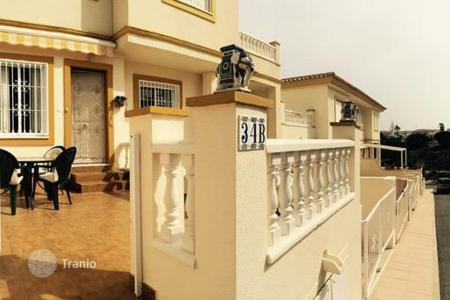 Cheap townhouses for sale in Valencia. Cosy bungalow in a privite development, Orihuela, Spain