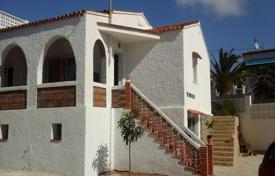 Coastal houses for sale in Spain. Two-storey villa with garden only 20 meters from the sea in Calp, area Carrió