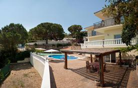 4 bedroom houses for sale in Spain. Three-level villa with a pool, a garden and a garage 300 meters from the sea, Costa Brava, Spain