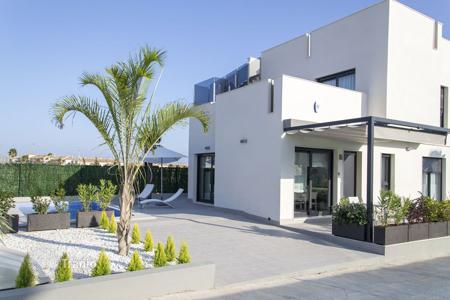 Houses for sale in Valencia. Modern villa with terrace, solarium and swimming pool, in Torrevieja, Alicante, Spain