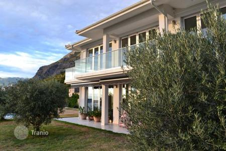 Houses with pools for sale in Budva. Luxury real estate — two-storey villa in Reževići with a magnificent panoramic view of the sea