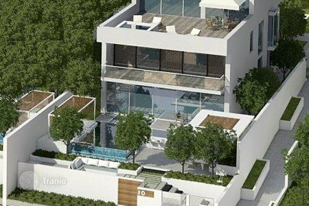 Luxury houses for sale in Western Asia. Modern villa with pool, garden and sea views in a new residential complex, in the area of Palm Jumeirah, Dubai
