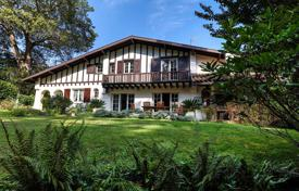 4 bedroom houses for sale in Biarritz. Traditional Basque style villa on a plot with a garden and a garage, in a private picturesque place near a lake, Biarritz, France