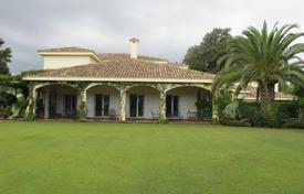 Luxury 4 bedroom houses for sale in San Roque. Elegant villa with a tropical garden, garages and a heated swimming pool, in a prestigious area, Sotogrande, San Roque