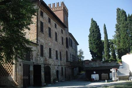 Houses for sale in Lombardy. Historic building with medieval walls and tower which give a fascinating and romantic atmosphere to the property