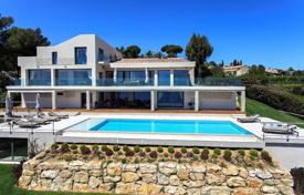 Luxury 5 bedroom houses for sale in Cannes. Three-storey sea view villa with an open-air swimming pool, Cannes, France