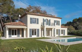 Houses with pools for sale in Provence - Alpes - Cote d'Azur. Modern villa with a private plot and a swimming pool in an elite residential complex near the historic center of the city, Mougins, France
