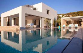 Elegant furnished villa overlooking the sea and the southern forest in Porto Heli, Peloponnese, Greece. Price on request