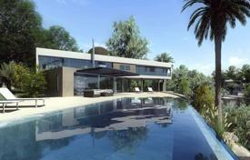 Houses with pools by the sea for sale in Costa del Sol. Modern villa with a terrace, a swimming pool, a tropical garden and sea views, close to the beach, Benalmadena, Spain
