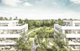 New homes for sale in Bavaria. New apartments in a modern complex next to the wood on the outskirts of Munich — Ottobrunn
