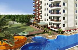 Coastal new homes for sale in Western Asia. Furnished apartments in a comfortable residence with a parking, a sauna and a gym, Mahmutlar, Turkey