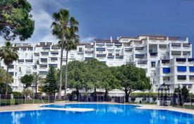 Luxury apartments for sale in Spain. Modern apartment with a terrace in a complex with gardens, a pool, a parking and a direct access to the beach, Puerto Banus, Spain
