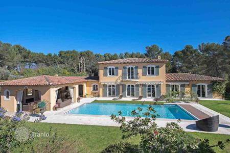 Luxury houses with pools for sale in France. Cozy Provencal-style villa with a fireplace, a garden and a swimming pool, Mougins, France