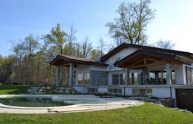 Modern villa with a terrace, lake views, a pool and a spacious plot, Agrate-Conturbia, Piedmont, Italy. Price on request