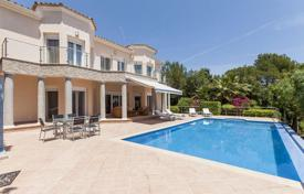 Houses for sale in Majorca (Mallorca). Villa with panoramic infinity pool on the large terrace near the town of Pollensa, Mallorca, Spain. High rental potential!