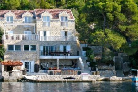 Property for sale in Dubrovnik Neretva County. Stone villa on the front coastline near a small port, Pelješac peninsula, Croatia. High rental potential!