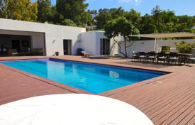 Luxury houses with pools for sale in Spain. Furnished villa with a garden, a swimming pool, a terrace and a sea view, Ibiza, Spain