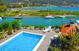 Coastal houses for sale in Igalo. Fully equipped villa with 5 apartments, private dock on the sea front in Igalo, Bay of Kotor. Profitable investment!