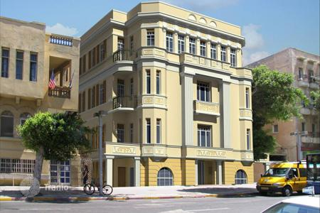 "Coastal apartments for sale in Tel Aviv District. The building is built in 1931 in the style of ""Bauhaus"""
