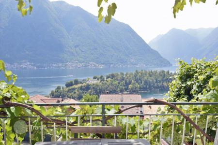 6 bedroom houses for sale in Lake Como. Refurbished historic building with a view of Lake Como, Ossuccio, Italy