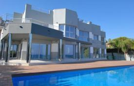 5 bedroom houses by the sea for sale in Costa Blanca. New, modern villa by the sea, with garden, swimming pool and parking, in Calpe, Alicante