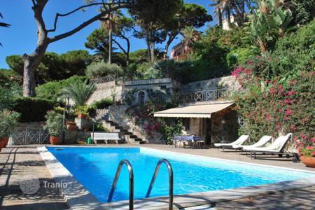 6 bedroom houses for sale in Italy. Three-storey villa with pool, garden and views of the port, 50 meters from the sea in Bordighera, Liguria, Italy