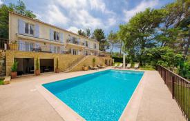 Luxury houses with pools for sale in Mougins. Renovated cottage with a pool, a garden, a fountain, a garage, a terrace and a view of the hills, near the waterfront, Mougins, France