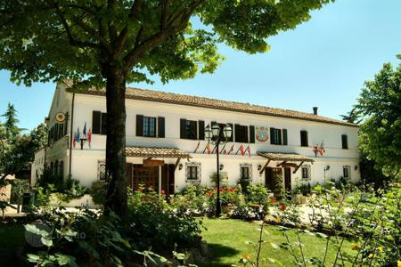Coastal property for sale in Marche. A country house Hotel and Restaurant with mature gardens and a swimming pool