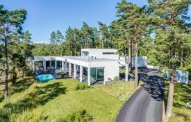 Property for sale in Northern Europe. Designer villa with a private garden, a swimming pool, a spa, a garage, a mooring for boats and sea views, Kirkkonummi, Finland