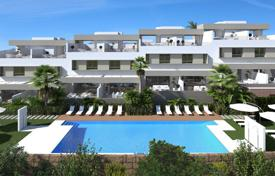 Townhouses for sale in Costa del Sol. New townhouse with a terrace and a sea view in a residential complex with a garden and swimming pools, Mijas, Spain