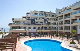 Property for sale in Manilva. Cozy apartment with sea views in a residential complex with a garden and a swimming pool, Manilva, Spain