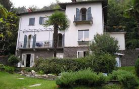 Houses for sale in Stresa. Spacious villa with a balcony, a pond and lake views, Stresa, Piedmont, Italy