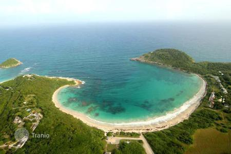 "Land for sale in Caribbean islands. ""Spectacular ocean views"""
