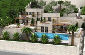 Luxury houses with pools for sale in Western Asia. New villa with guest house, private pool and a spacious terrace overlooking the sea in the center of Kalkan, Antalya, Turkey