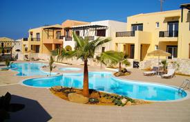 Apartments with pools for sale in Rethimnon. New apartment with a garden, a terrace and mountain views in a residential complex with pools and a common garden, Rethymnon, Greece
