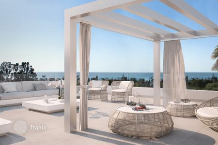 Apartments with pools by the sea for sale in Costa del Sol. Apartments in a new gated residential complex with an underground parking, a pool and a garden, near the golf club, Marbella, Spain