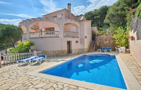 Houses with pools by the sea for sale in Costa Brava. Spasious villa with a pool, a garden and terraces with a sea view, 150 meters from the beach, Palafrugell, Spain