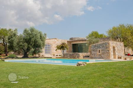 Luxury houses for sale in Apulia. Reconstructed historic villa with a roof-top terrace, a swimming pool, a garden, and a sea view, Salve, Italy