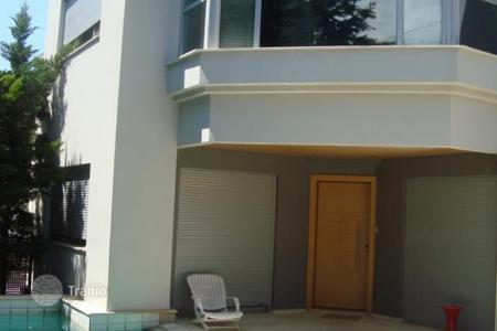 Houses with pools for sale in Attica. A three-storey house with pool in the southern district of Athens