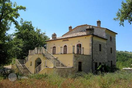 6 bedroom houses for sale in Abruzzo. Furnished ancient villa with panoramic views, surrounded by woods, at the foot of the Majella Mountains, in Abbateggio, Italy