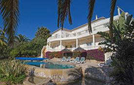 Houses with pools for sale in Faro. 4 bedroom villa with private infinity pool, stunning location, Budens, West Algarve